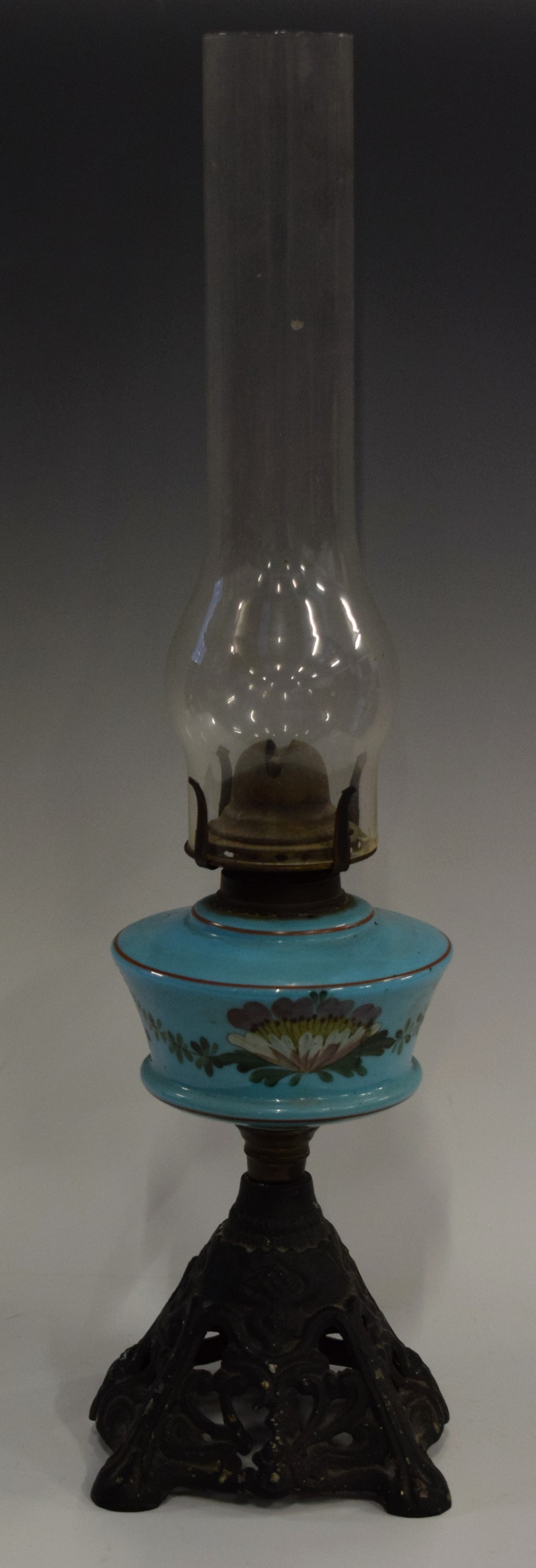 Lot 24 - A Victorian blue milk glass and enamelled oil lamp