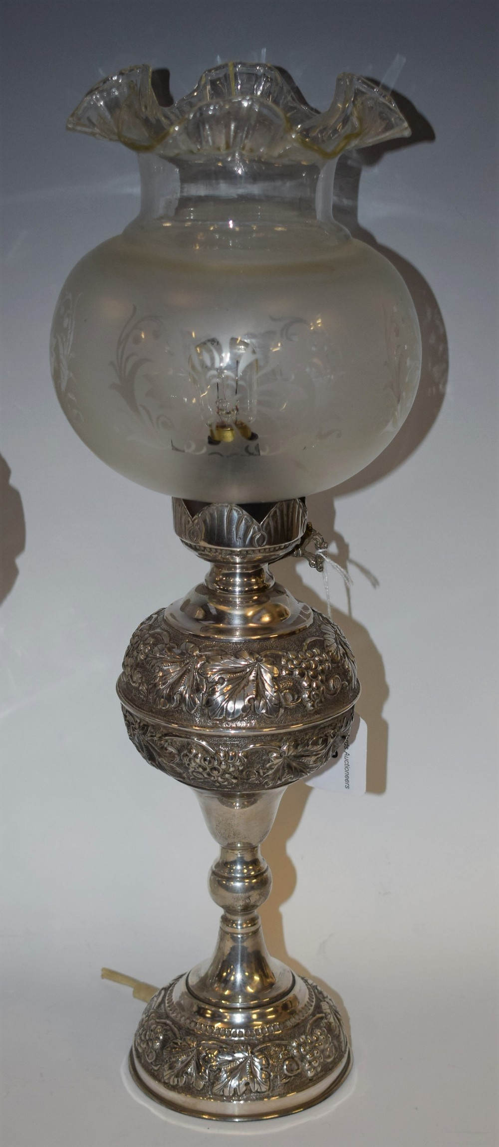 Lot 2 - A 925 silver table lamp, the reservoir embossed with fruiting vine, knopped columns, domed base,