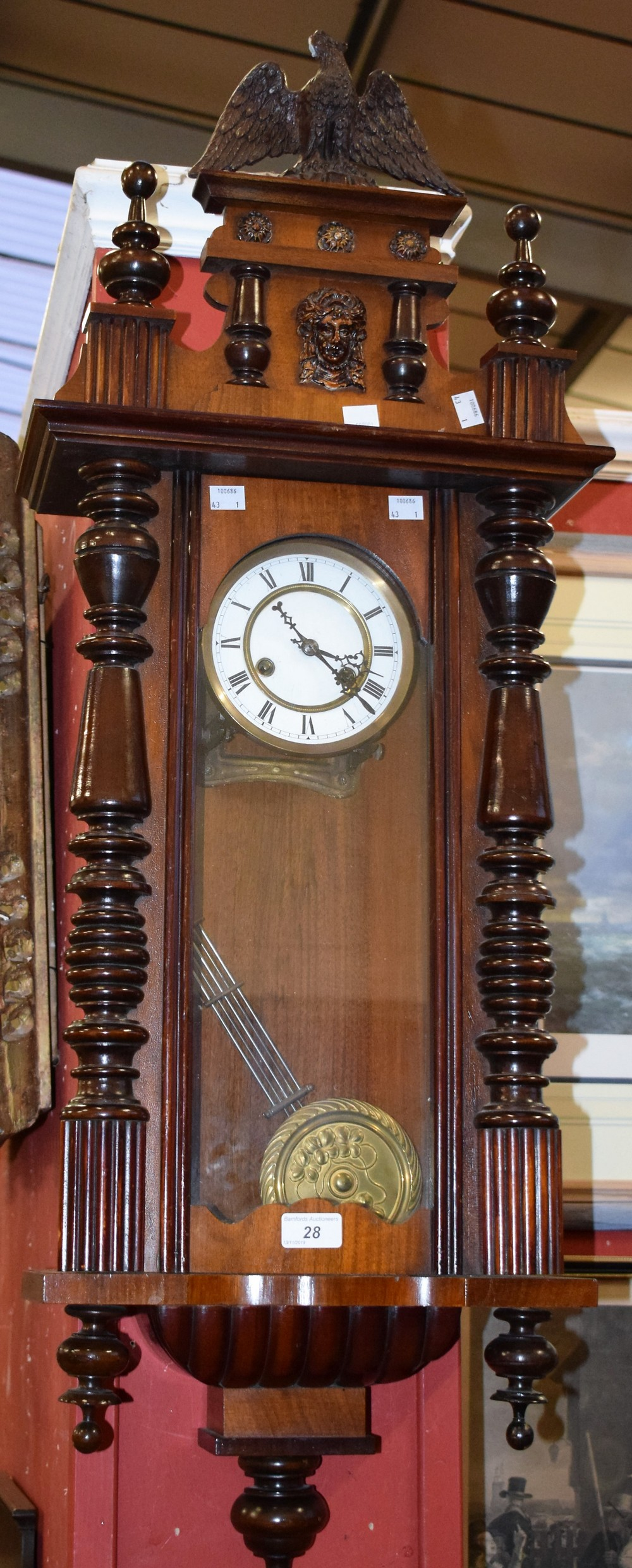 Lot 28 - A mahogany cased Vienna type wall clock, architectural pediment crested by an eagle,