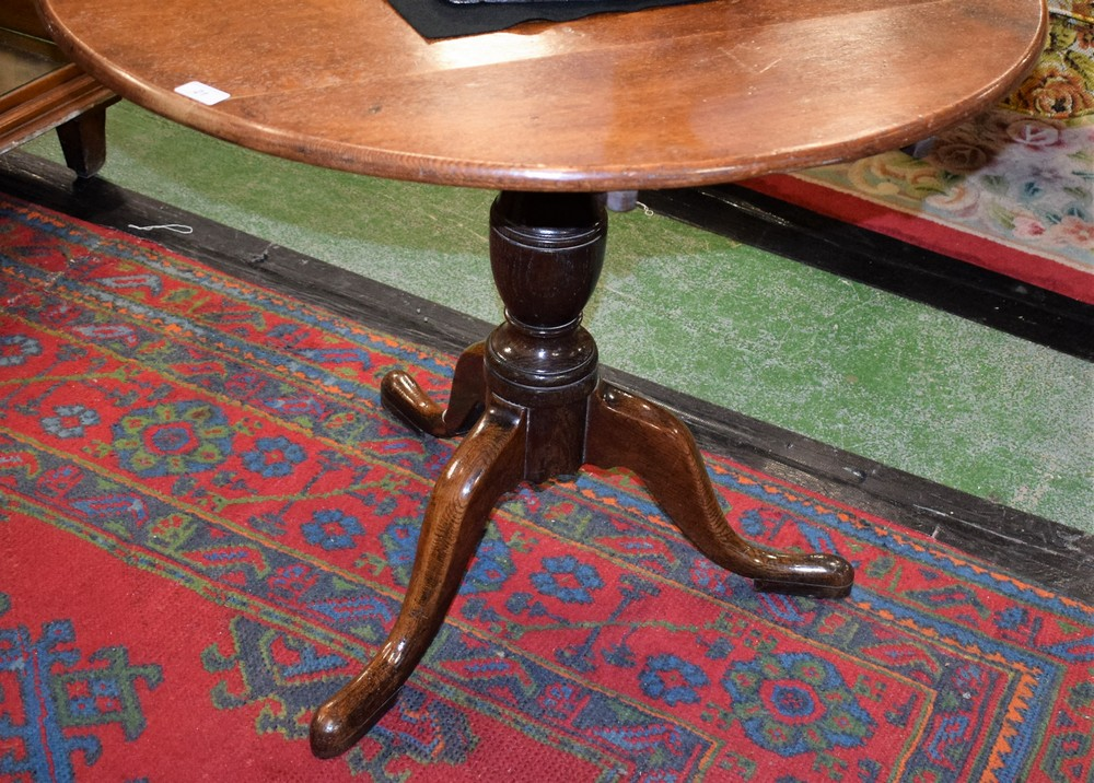 Lot 21 - A George III oak tripod occasional table, circular tilting top, turned baluster column,