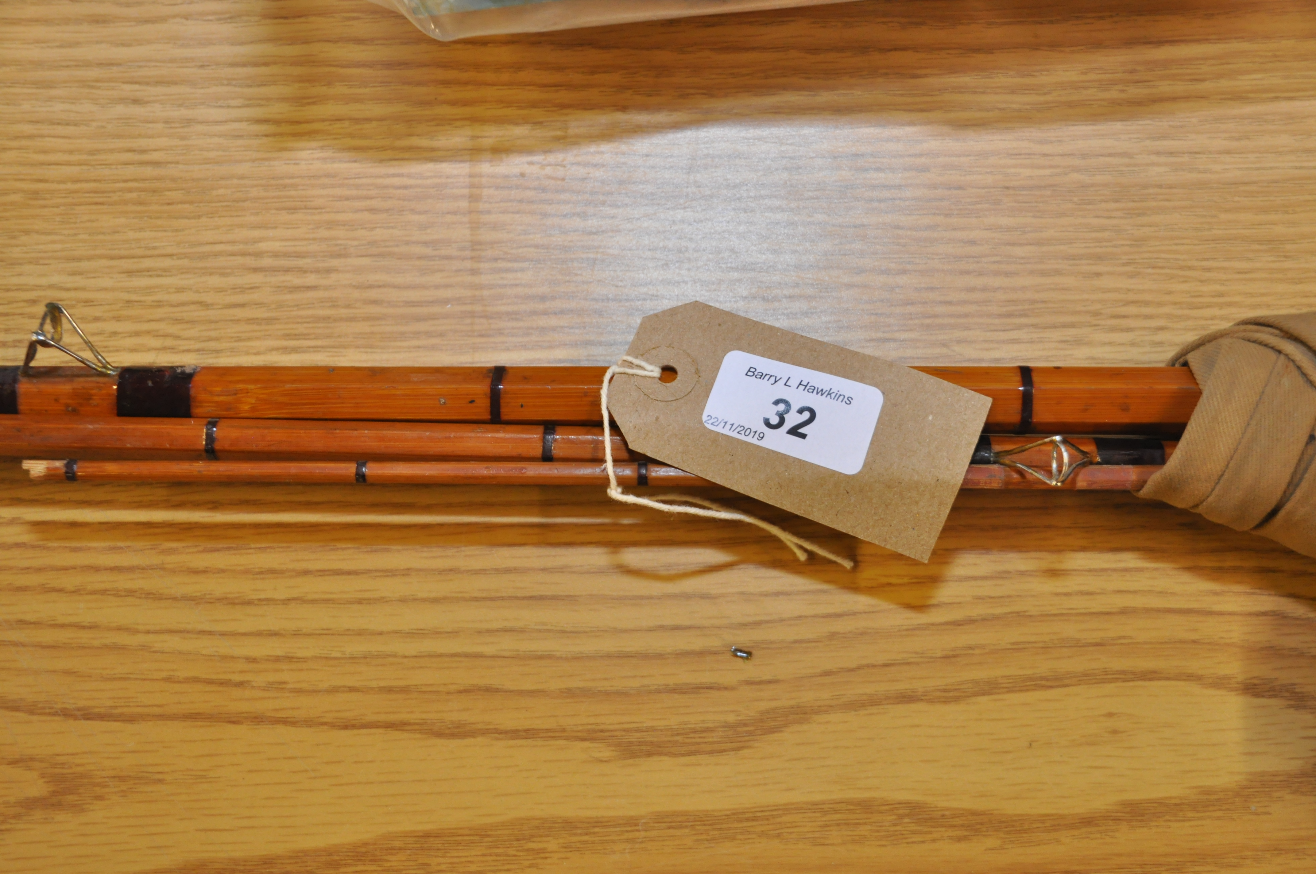 Lot 32 - SPLIT CANE ROD WITH GLASS TOP AND SPARE TOP