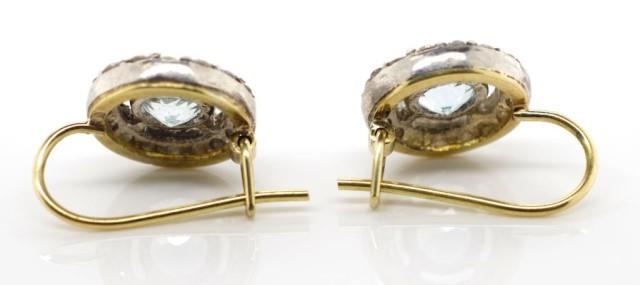 Lot 43 - Aquamarine and diamond halo earrings