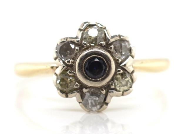 Lot 17 - Diamond and sapphire set gold daisy ring