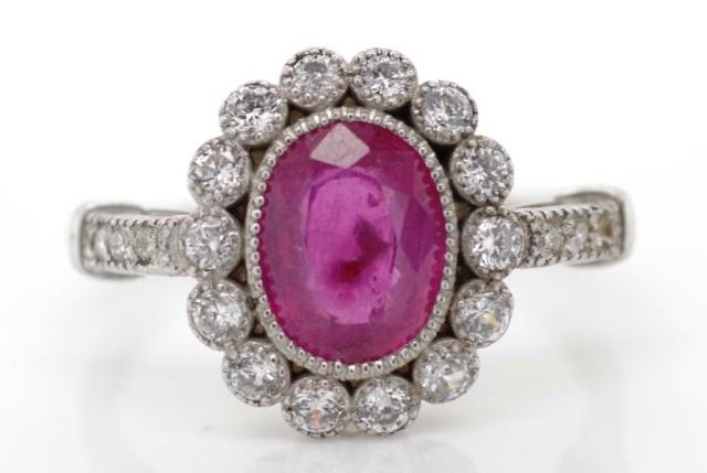 Lot 30 - Ruby and diamond set 18ct gold cluster ring,