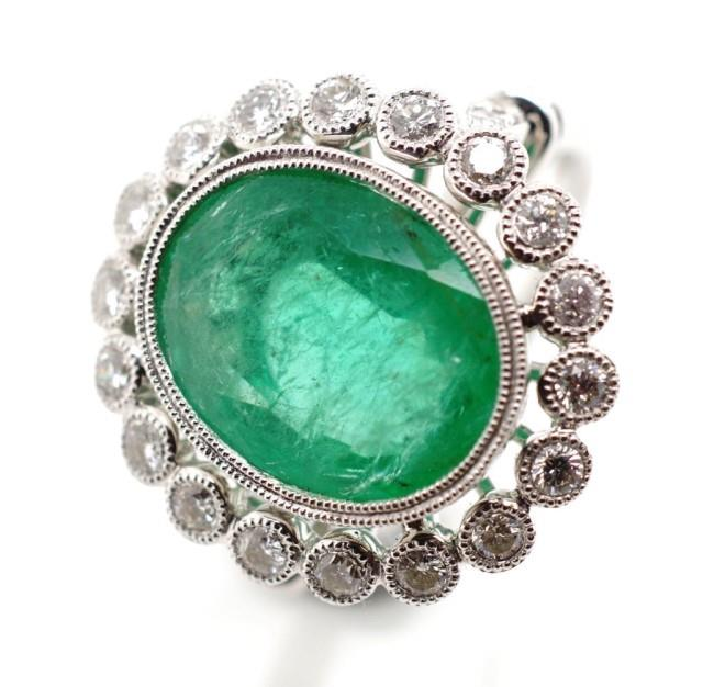 Lot 32 - 4.89ct Emerald and diamond 18ct white gold ring