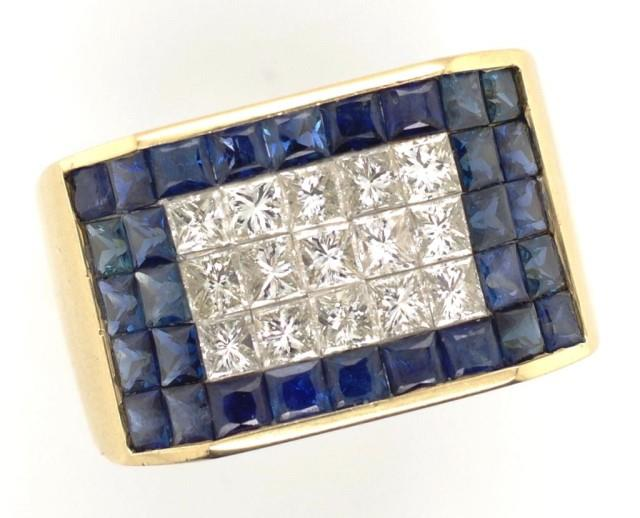 Lot 53 - Princess cut diamond and sapphire 14ct gold ring