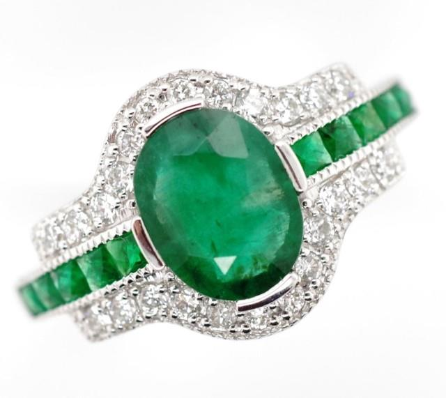 Lot 50 - Emerald and diamond set 18ct white gold ring