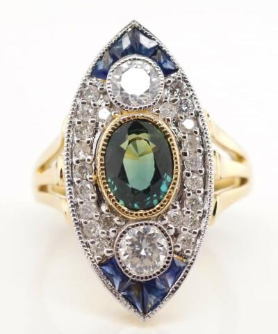 Lot 52 - Diamond and sapphire set 14ct gold cocktail ring