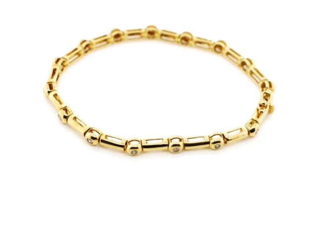 Lot 3 - Diamond and 18ct yellow gold line bracelet