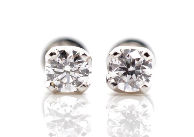 Lot 5 - 0.65ct Diamond and 18ct white gold stud earrings