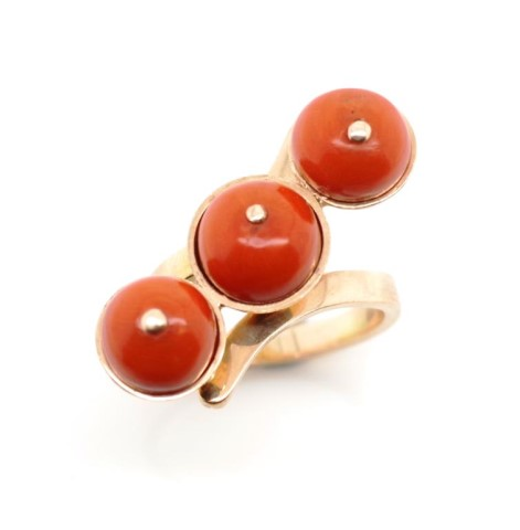 Lot 41 - 14ct rose gold and three stone coral ring