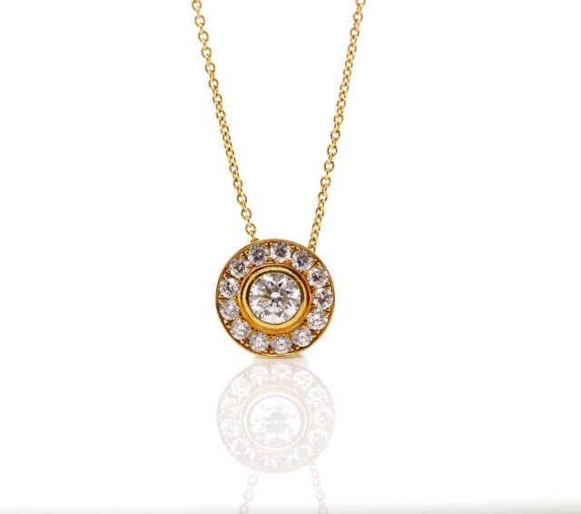 Lot 2 - 0.80ct diamond set 18ct halo pendant and chain