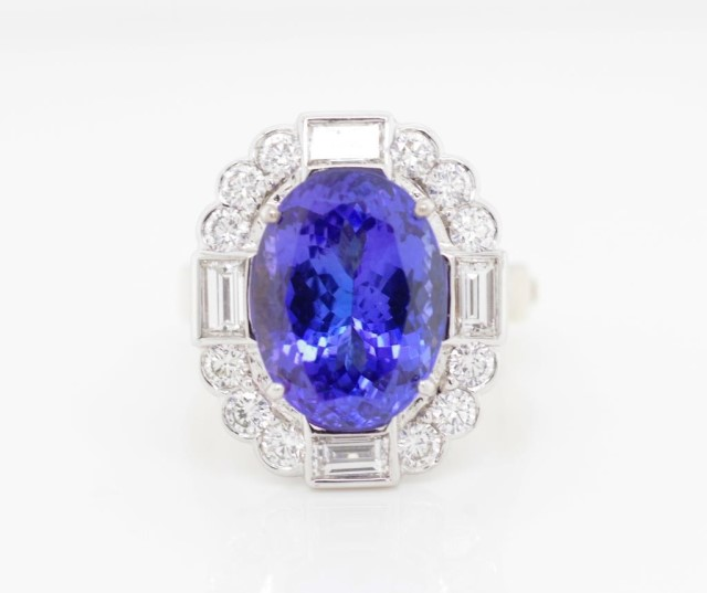 Lot 49 - Tanzanite and diamond set 18ct two tone gold ring
