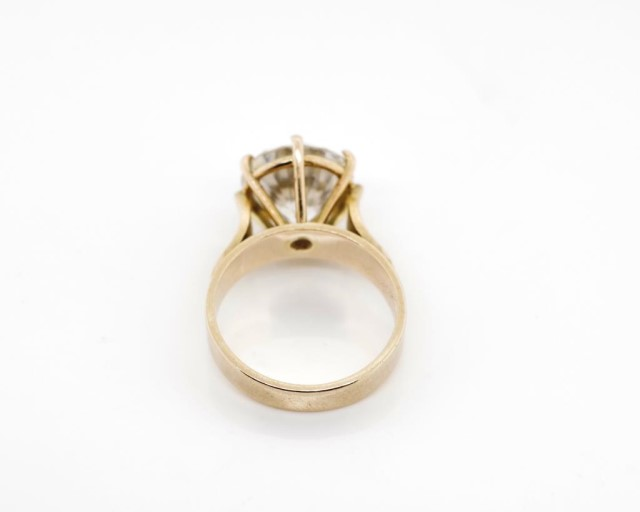 Lot 35 - 9ct rose gold and cubic zirconia cocktail ring