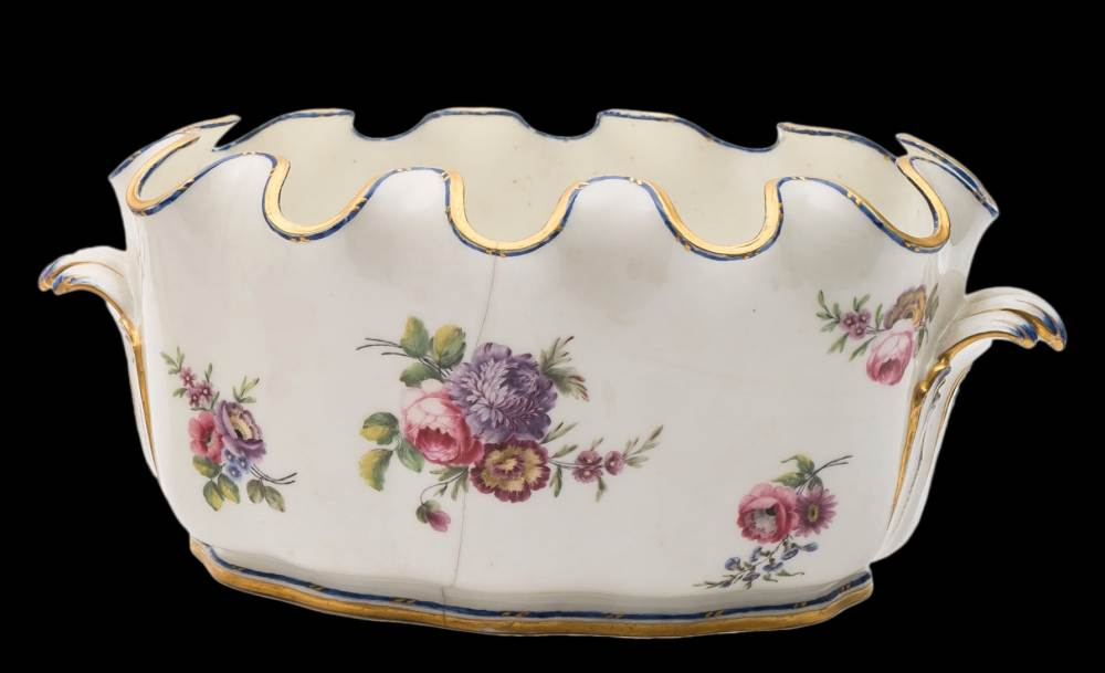 A pair of Sèvres porcelain verrières: each of lobed oval form with crenellated rim and scroll