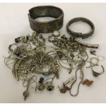 A bag of scrap silver and white metal jewellery, some items stone set.