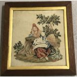 Oak framed Victorian wool work tapestry of a girl sitting with a basket.