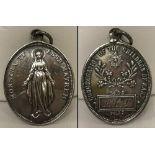 An antique silver medallion Hallmarked Birmingham 1908.