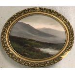 Oval shaped oil on board of a Scottish heathland scene in ornate gilt frame.