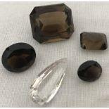 4 loose smocked quartz gemstones together with a teardrop cut rock crystal stone.