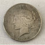 A 1925 silver Peace dollar converted to a brooch.
