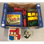 A box of mixed vintage toys.