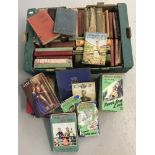 A collection of vintage books, mainly children's story books.