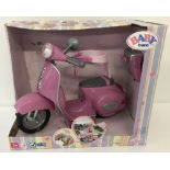 A brand new boxed Zapf Creations Baby Born remote control Vespa style scooter.