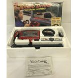 1980's boxed Sega Action GT Video Driver video game with California Chase VHS.