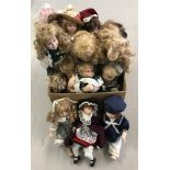 A box of 18 modern porcelain dolls in traditional dress.
