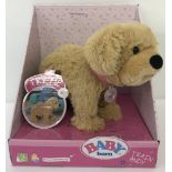 A brand new boxed Zapf Creations Baby Born Andy dog. Ex shop stock.