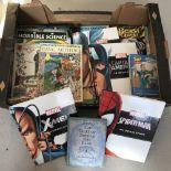 A box of mixed children's books.