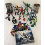 A box of 7 Lego Bionicle figures some with original boxes and instruction leaflets.
