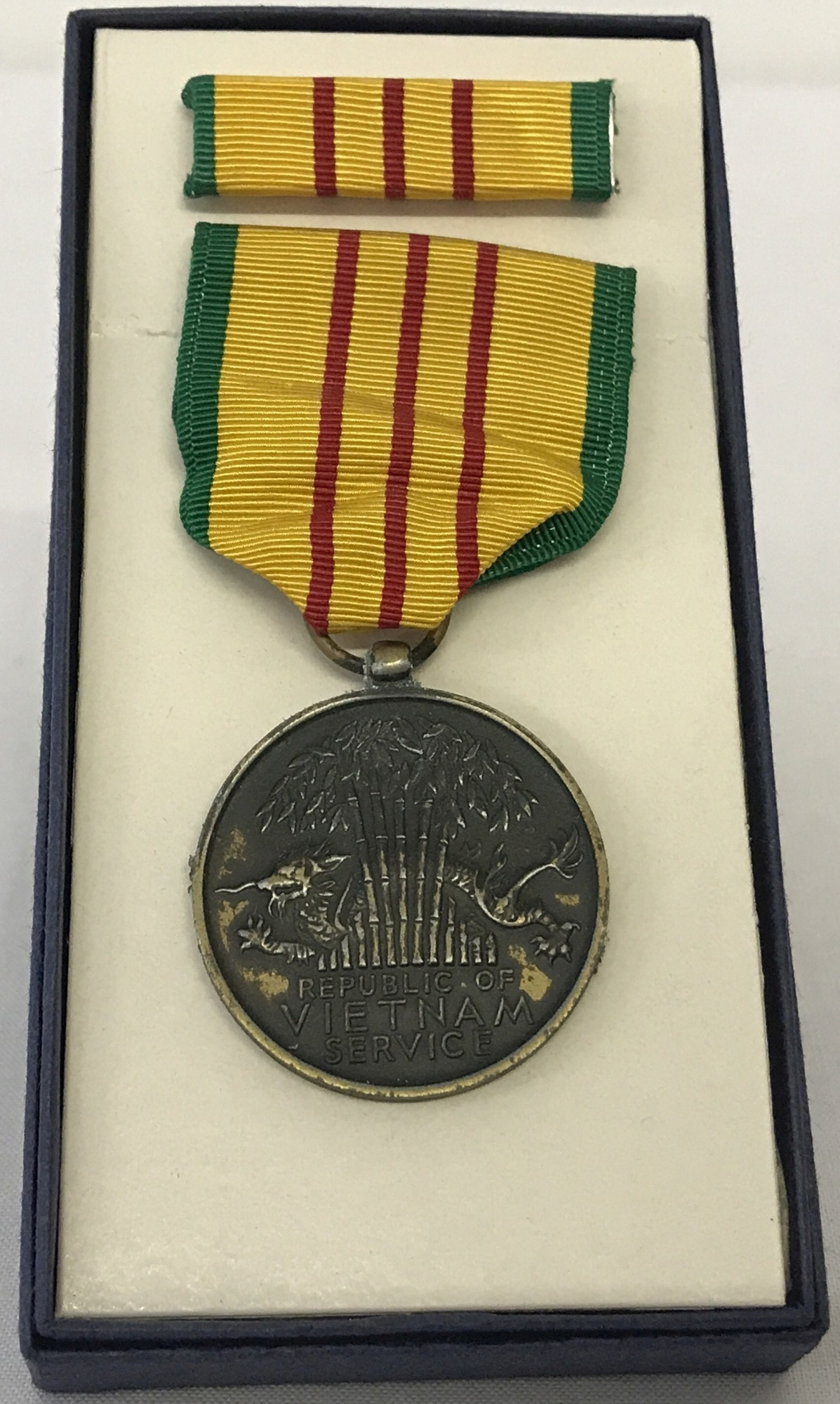 Lot 9 - Boxed Vietnam War Style Service Medal and ribbon bar.