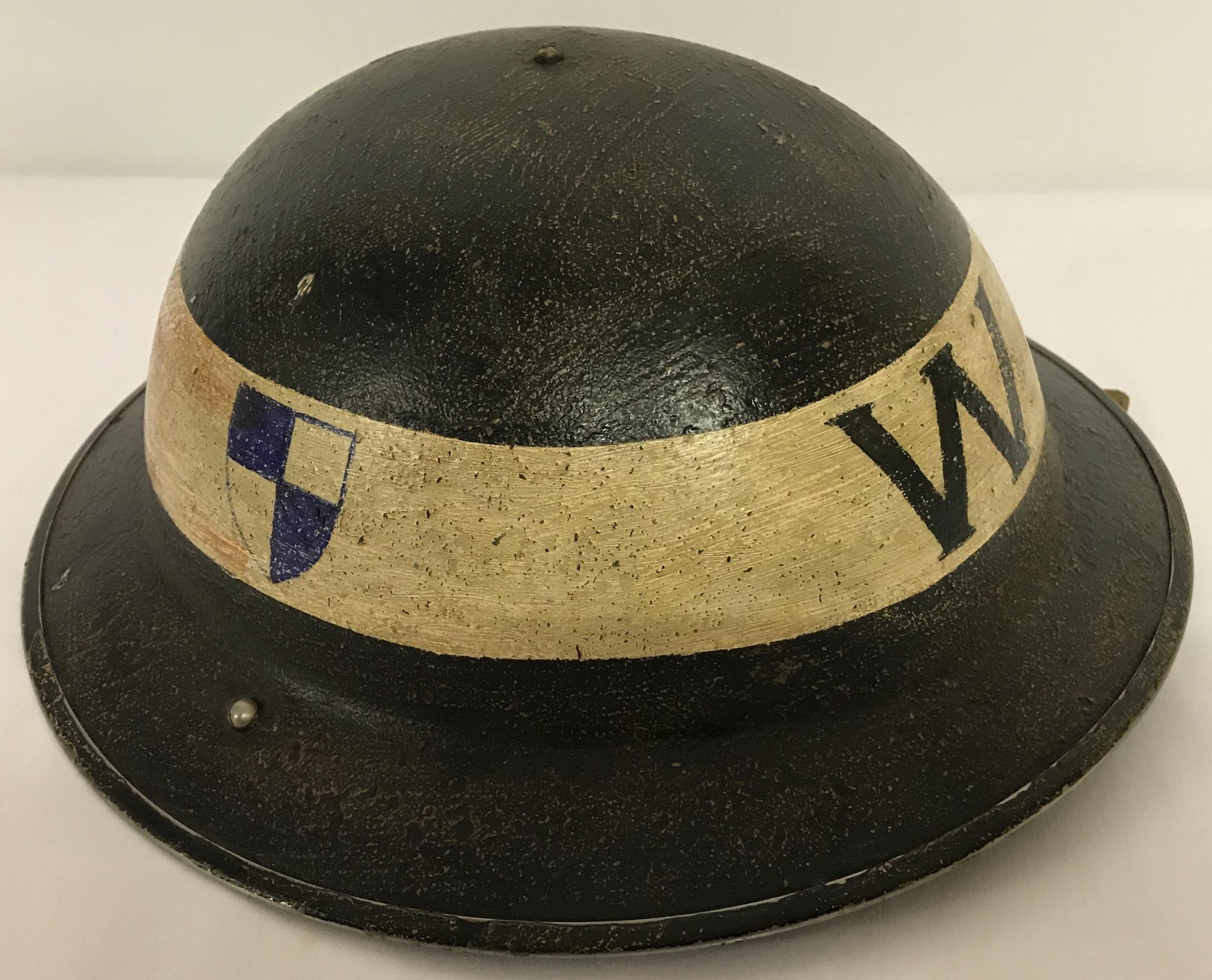 Lot 221 - A British MK II Civil Defence/Home Front steel helmet c1939.