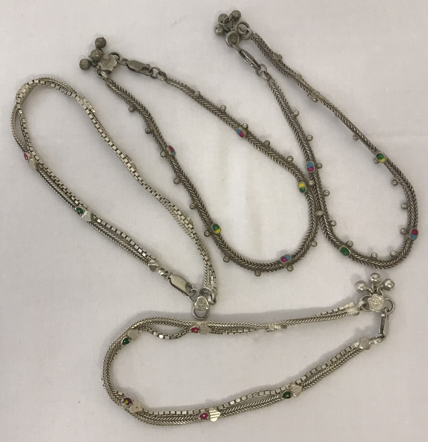 Lot 12 - 4 Indian white metal decorative ankle chains.