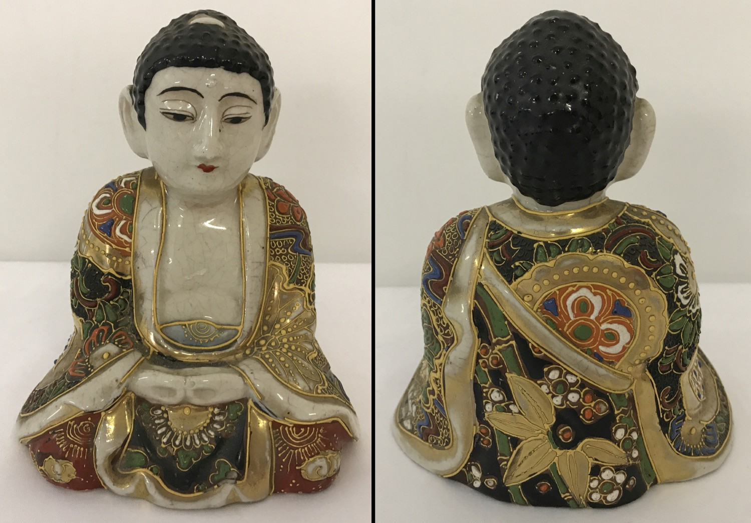 Lot 38 - A ceramic sitting Buddha figure with gilt and hand painted floral decoration to his robe.