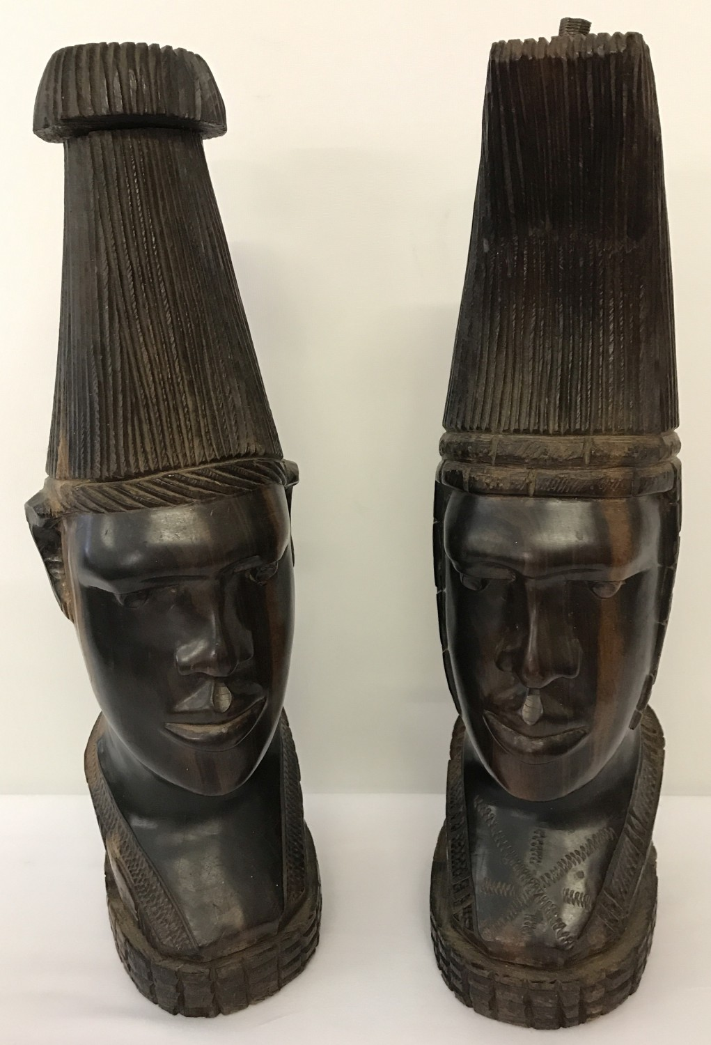 Lot 105 - A pair of heavy solid dark wood African tribal man and woman figurines.