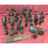 Lot 108 - A large collection of carved dark solid wood tribal figures.
