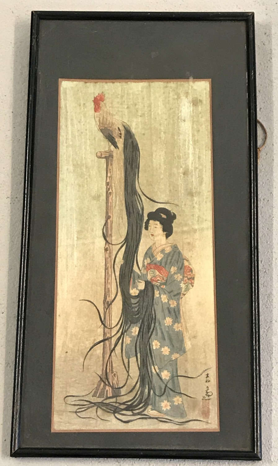 Lot 145 - A framed and glazed oriental watercolour depicting an oriental lady and a cockerel on a stand.
