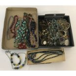2 trays of vintage and modern necklaces.