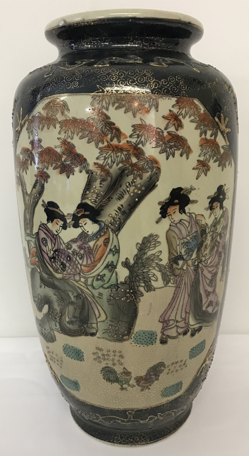 Lot 36 - A ceramic Satsuma vase decorated with oriental ladies in a garden.