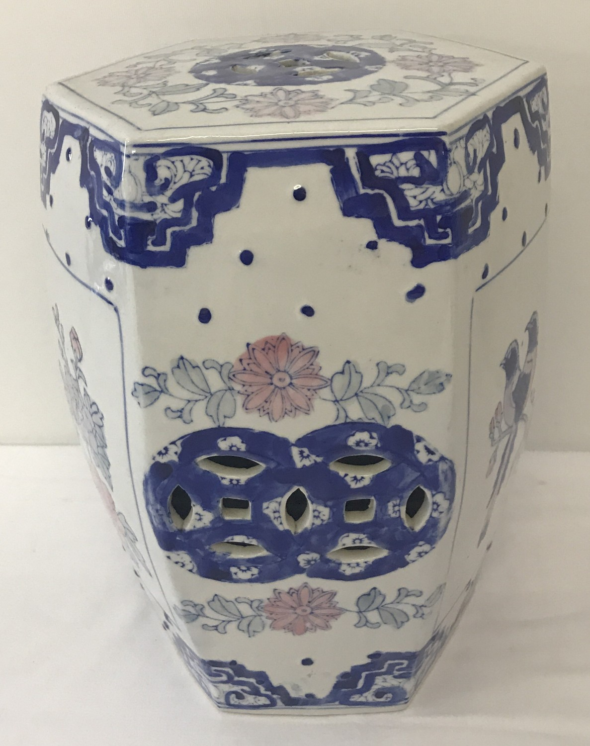 Lot 76 - A Chinese hexagonal ceramic stool with pierced detail to sides and top.