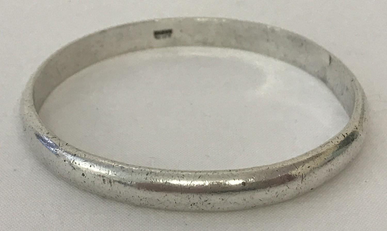 """Lot 15 - A Zambian silver bangle. Marked """"KABWE Silver"""" to inside of bangle."""