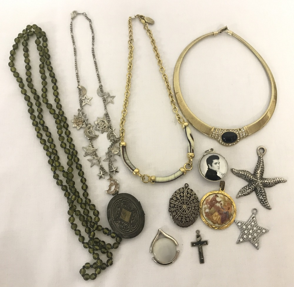 Lot 114 - A small collection of vintage and modern necklaces and pendants.