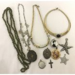 A small collection of vintage and modern necklaces and pendants.