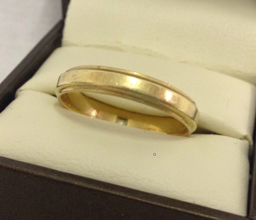 Lot 45 - A 14ct gold wedding band. Size U. Total weight approx. 3.8g.