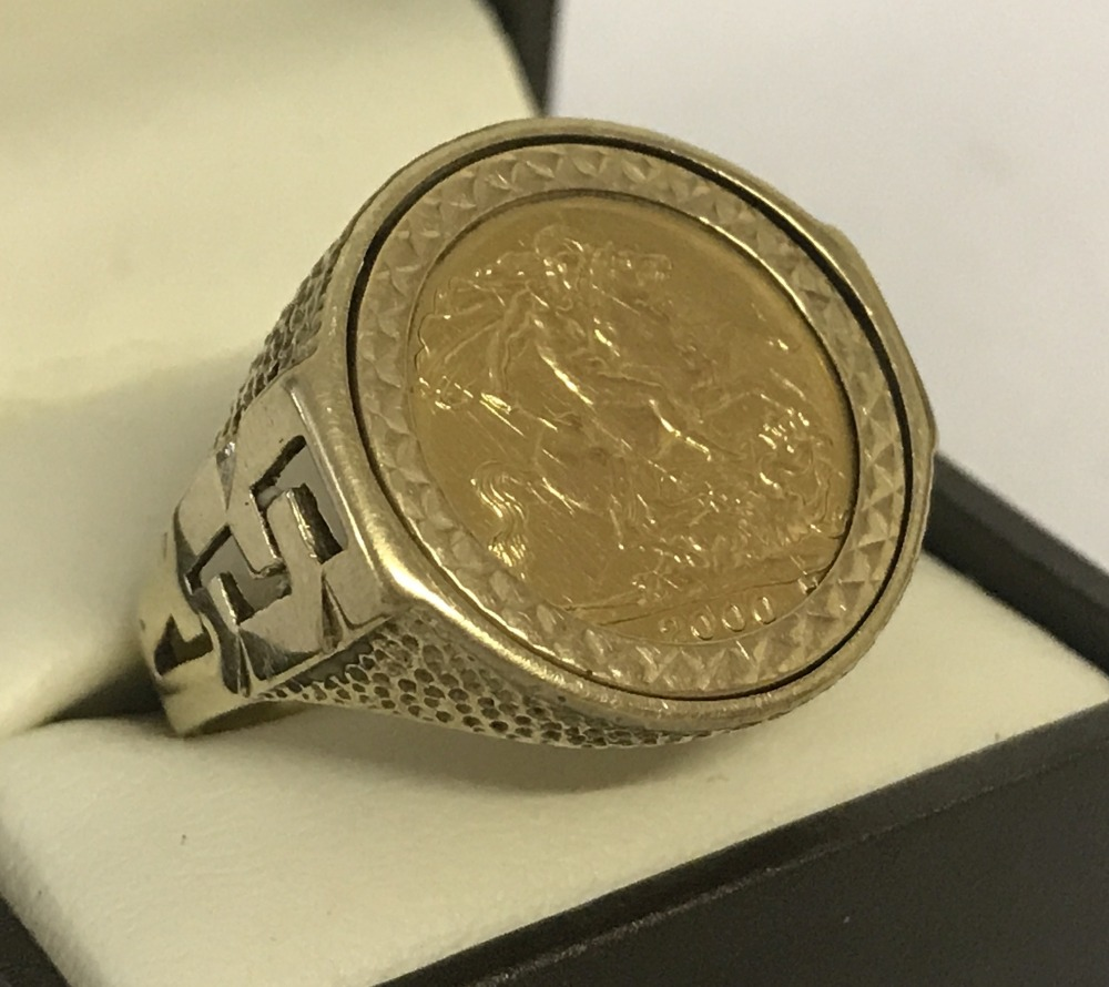 Lot 101 - An Elizabeth II full sovereign, dated 2000, set in a 9ct gold men's ring.