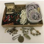 A box of vintage and modern costume jewellery and men's cufflinks.
