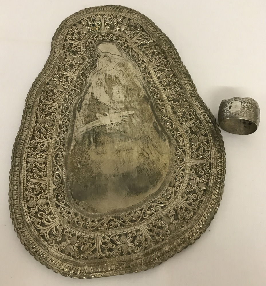 Lot 142 - A white metal decorative presentation plate in the shape of Sri Lanka.